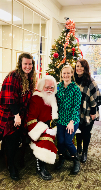 Deesha, Kristi, and Jessica with Santa